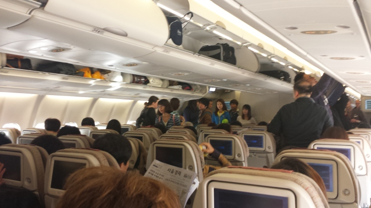 Asiana economy cabin - a global congregation like no other?